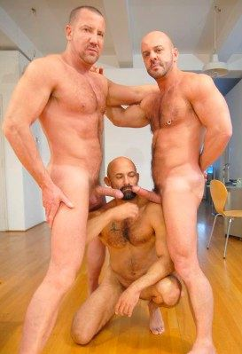Rocky Torrez on his knees with two cocks in his face