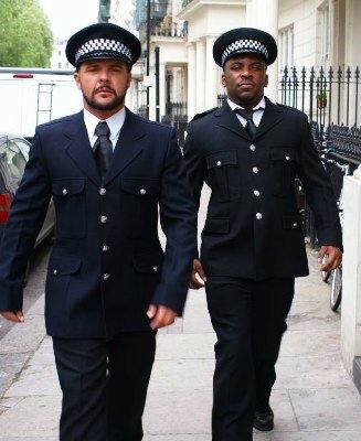 Two beefy guys in police uniforms