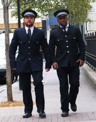 Marcus Troy and Sean Silver in UK police uniforms