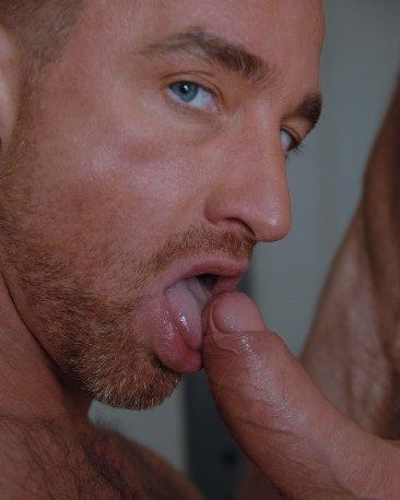 Scruffy Ross Hurston with uncut thick cock on his tongue