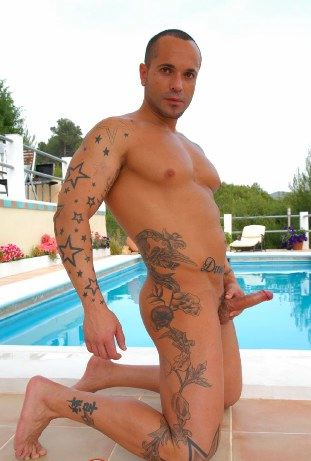 Hot inked Latin muscle boy strokes his hard dick