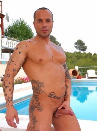 Latin muscle boy with tattooes strokes his dick