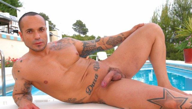 Tattooed muscle boy with soft cock poolside