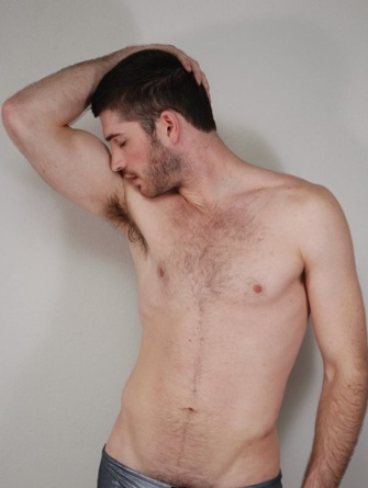 Hot young Dan shows off his hairy chest and pits