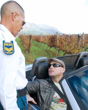 Kurt Rogers is pulled over bya hot  poilice officer
