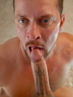 Vinnie D'Angelo sucking on a tattooed cock