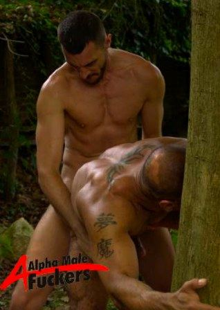 Tattooed muscle stud Pier Sias bent over, grabbing a tree, as he gets fucked by Ross Stevens