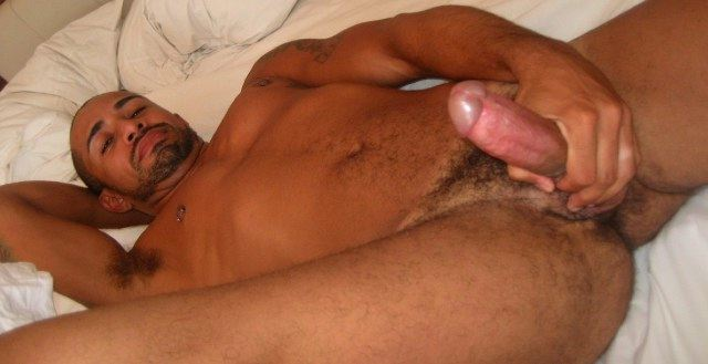 Smooth Latino guy strokes his huge hard on in bed