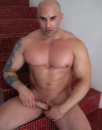 Beefy body builder strokes his hard cock