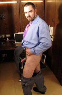 Bearded stud with hard cock at the office
