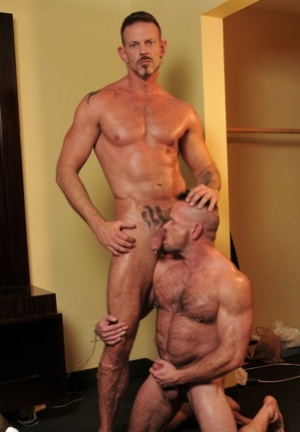 Peter Axel on his knees ready to service Collin Steele