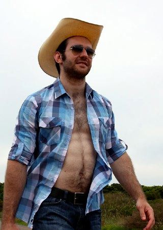 Shirtless scruffy young cowboy