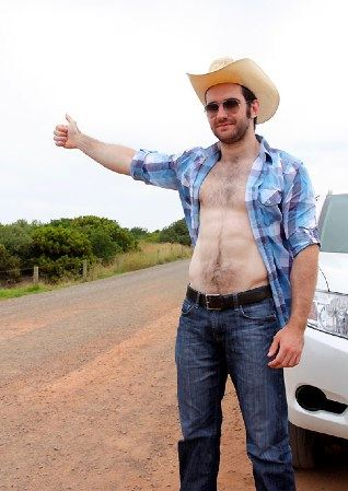 Hairy young cowboy hitchiking