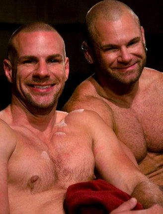 Sexy hunks together smiling