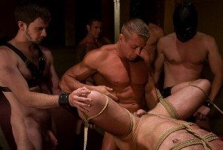 roped man getting fucked in group setting