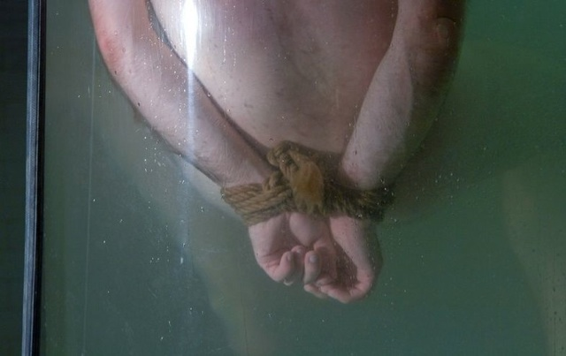 Dante's hands tied and underwater