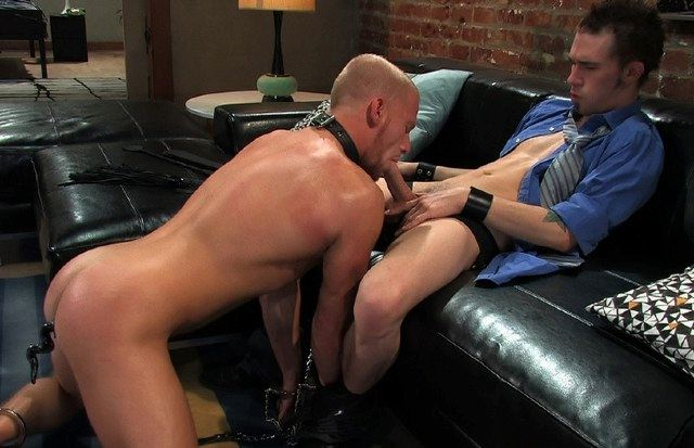 James makes his slave Luke suck his cock while bound and plugged