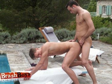 Smooth blond twink gets rammed from behind by cute college stud by a pool