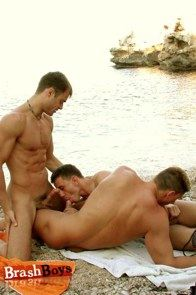 Three guys suck dick by the water