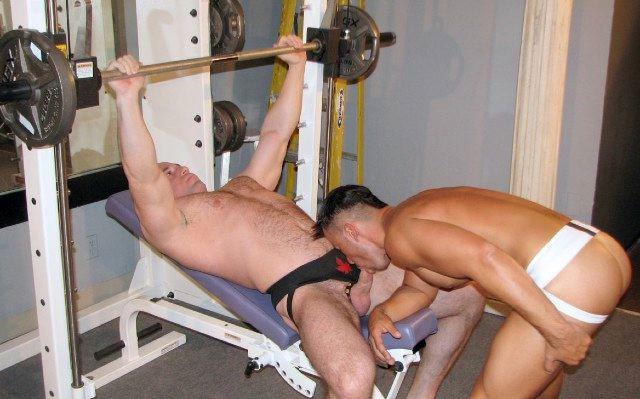 Muscle stud Kurt Reed bench presses while Dominik Rider sucks his dick.
