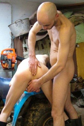 Smooth bodied hunk plays with his buds stretched nutsack and smacks his ass