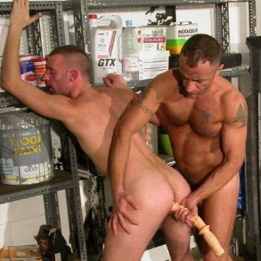 Danny Cannon pushes long dildo up hairy hunks hole.