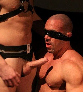 Blindfolded muscle guy and his top's rock hard uncut cock