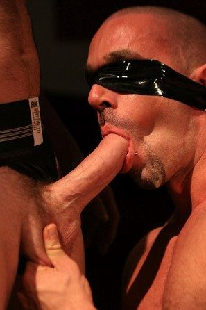 Blindfolded man sucking a big thick dick