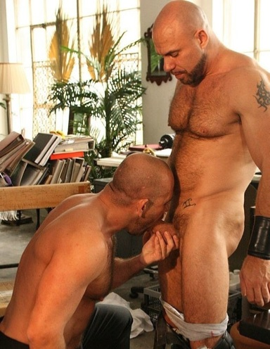 Marco De Brute gets on his knees and sucks Axel Ryders giant dick.