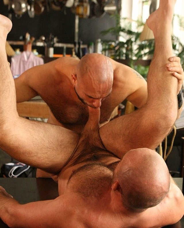 Axel Ryder lifts his buddy's legs and mouths his gigantic dick.