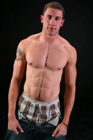 Furry muscle boy pulls down his pants
