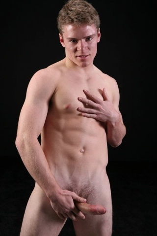 Cute young college jock strokes his thick dick