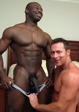 Hunky black dude shows how big his cock is soft