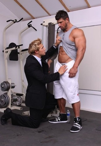 Suited Brady Jenson checking out Zeb's rock hard abs