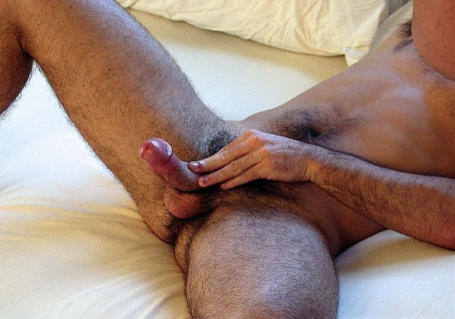 Slim guy plays with his cock