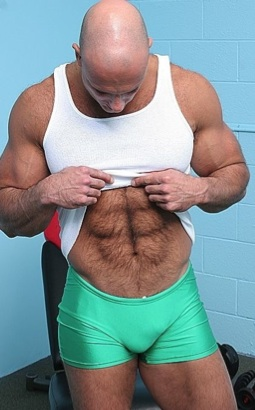 Bald stud shows off his furry abs