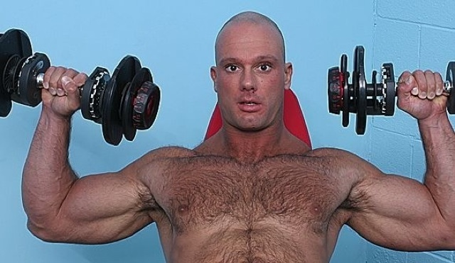 Bald hunk shows how big his muscles are