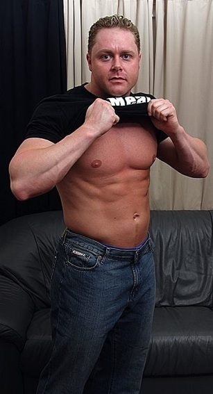 Ripped stud takes his shirt off