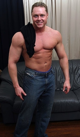 Built guy shows his smooth chest and abs
