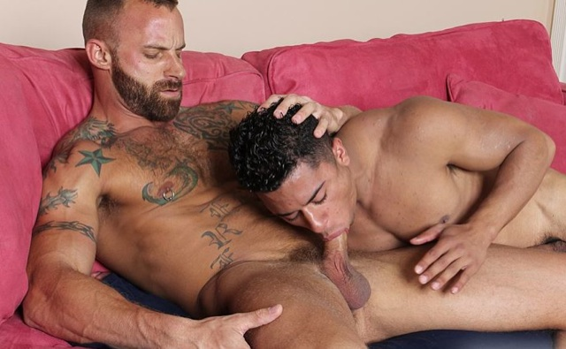 Hot tatttooed daddy getting a blowjob from a hot Latino cocksucker