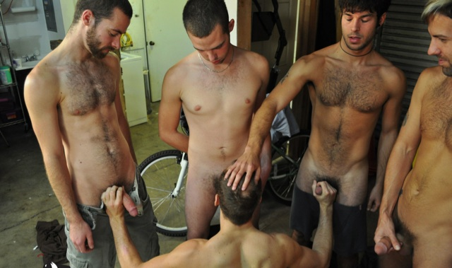 Young jock sucking cock while stroking two others