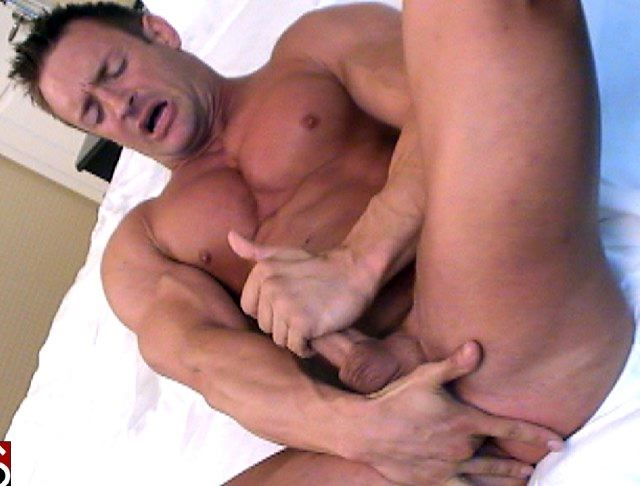 Muscle man fingers his hole while stroking his hard cock
