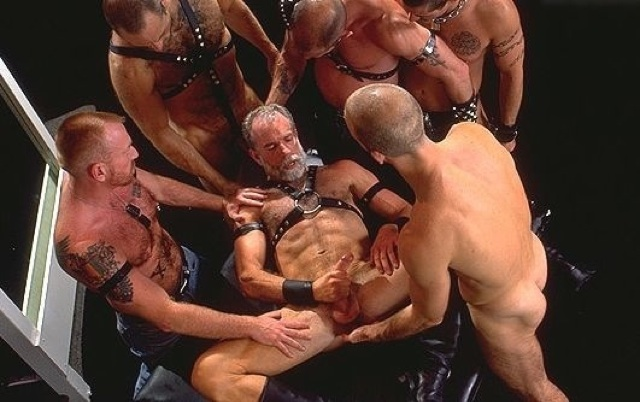 Older leather man jerks off while buddies watch
