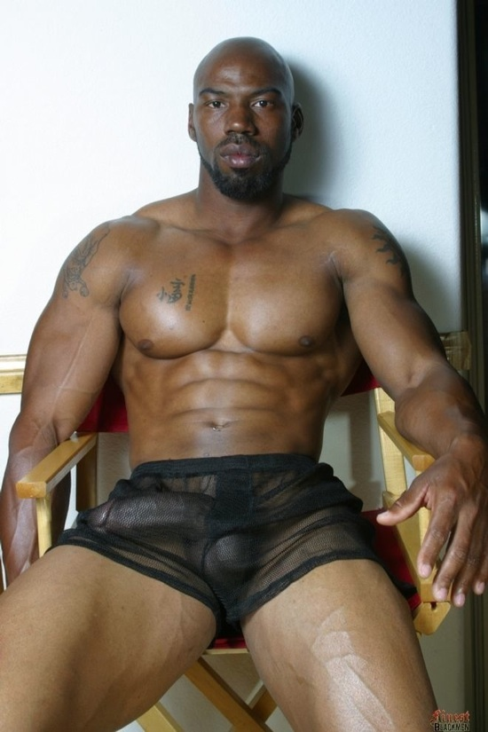 Smooth black body builder with a huge cock in his shorts