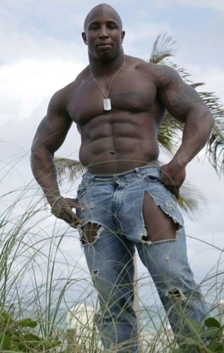 Bodybuilder shows his massive muscles and tight abs