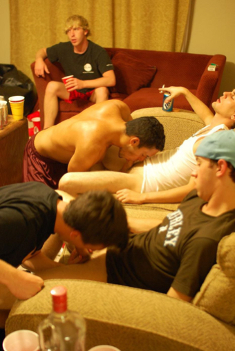 Two frat boys on their knees sucking dick