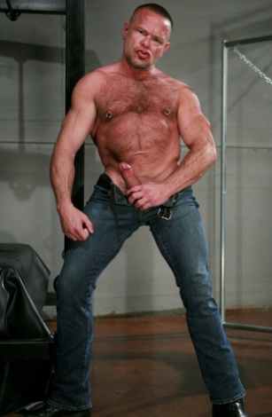 Peter Axel strokes his hard cock in jeans