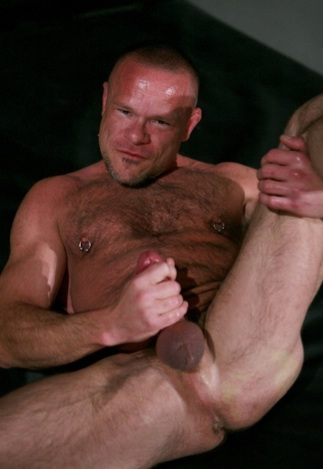 Peter Axel strokes his cock while showing off his hole