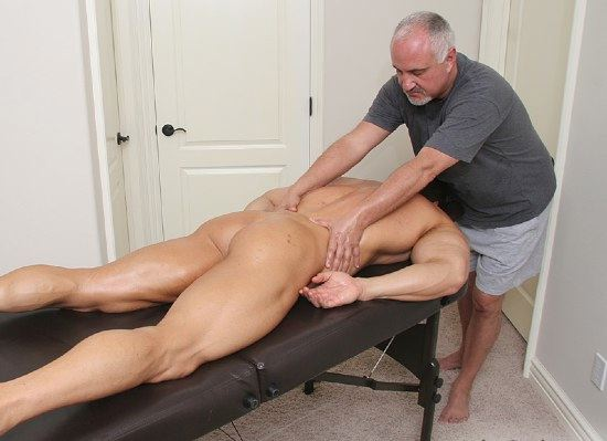 Older man gives smooth body builder a massage