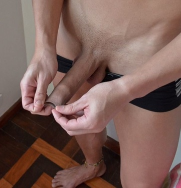 Young jock plays with his foreskin